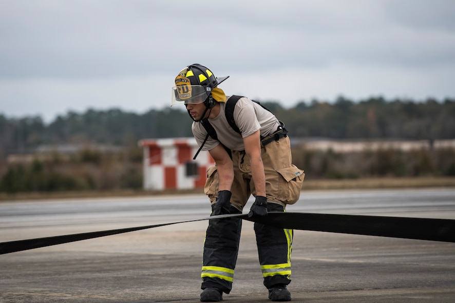 An Airman from the 23d Civil Engineer Squadron fire department prepares a cable to release an F-15C Eagle from an arresting system, Dec. 19, 2017, at Moody Air Force Base, Ga. The BAK-12 arresting system that is used on the runway to slow down fighter aircraft in emergency situations. The $250,000 system will now be completely replaced every 10 years. (U.S. Air Force photo by Senior Airman Janiqua P. Robinson)