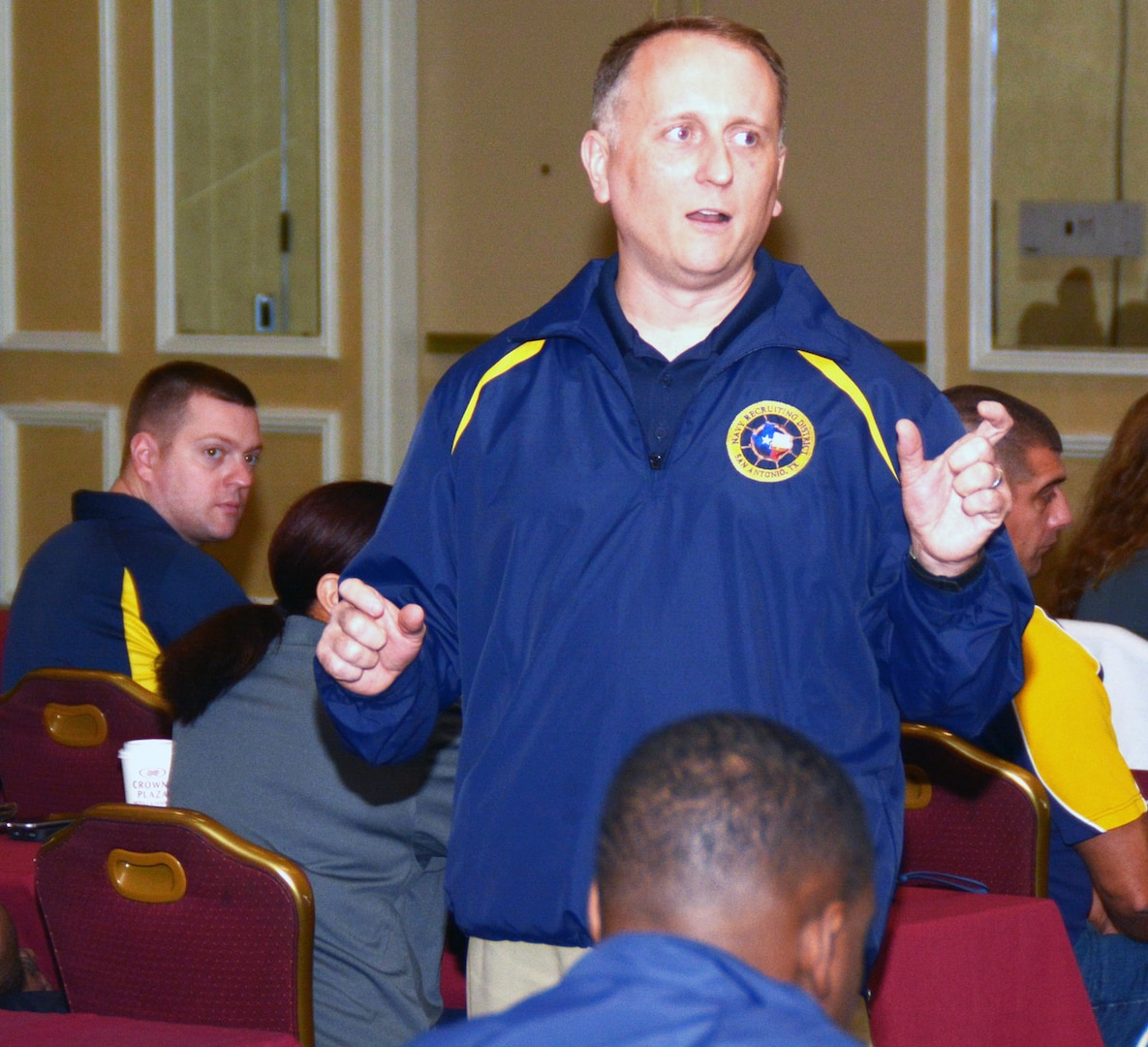 Cmdr. Jeffrey Reynolds, commanding officer of Navy Recruiting District San Antonio, addresses his Sailors and support personnel prior to the kick-off of Operational Stress Control training during the annual district training meeting held at the Crowne Plaza Hotel in Austin Dec. 19. More than 250 recruiters, support personnel and their spouses attended the training where facilitators of the Navy's 21st Century Sailor office provided attendees with support networks, programs, resources, training, and skills needed to overcome adversity and thrive.