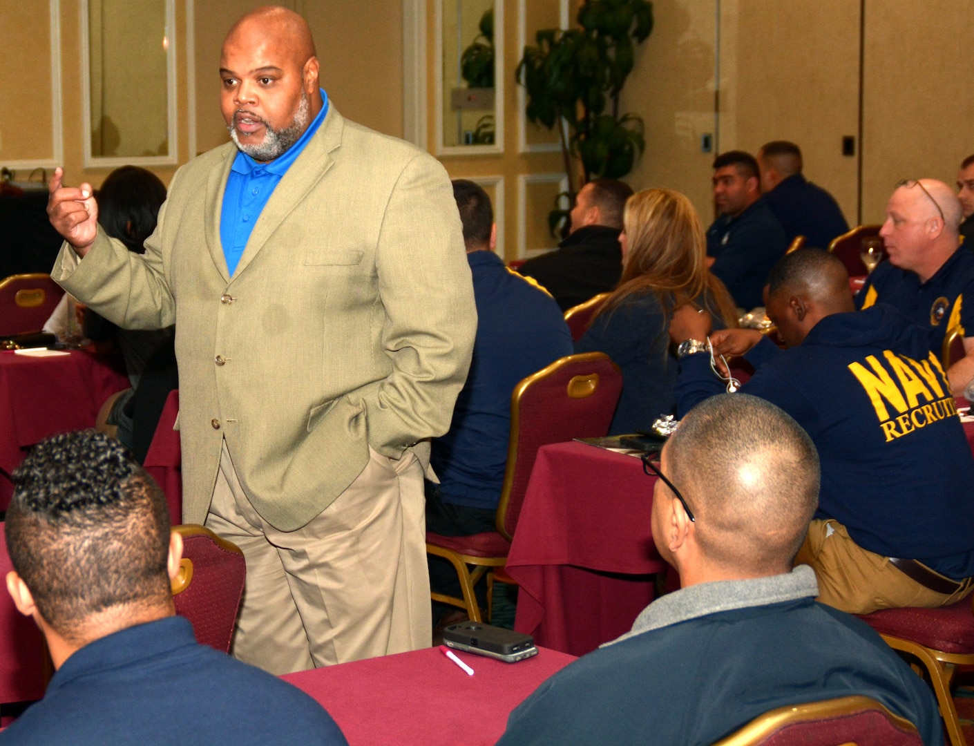 Navy veteran Torrence Simmons, a facilitator assigned to the Navy's 21st Century Sailor office in Norfolk, Va., speaks with first class petty officers and civilians of Navy Recruiting District San Antonio about operational stress control during a district training meeting held at the Crowne Plaza Hotel in Austin Dec. 19. More than 250 recruiters, support personnel and their spouses attended the training where they were provided with support networks, programs, resources, training, and skills needed to overcome adversity and thrive.