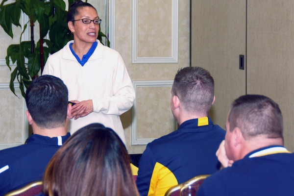 Navy veteran Martha Lara, a facilitator assigned to the Navy's 21st Century Sailor office in Norfolk, Va., speaks with officers and chief petty officers of Navy Recruiting District San Antonio about Operational Stress Control during a district training meeting held at the Crowne Plaza Hotel in Austin Dec. 19. More than 250 recruiters, support personnel and their spouses attended the training where they were provided with support networks, programs, resources, training, and skills needed to overcome adversity and thrive.