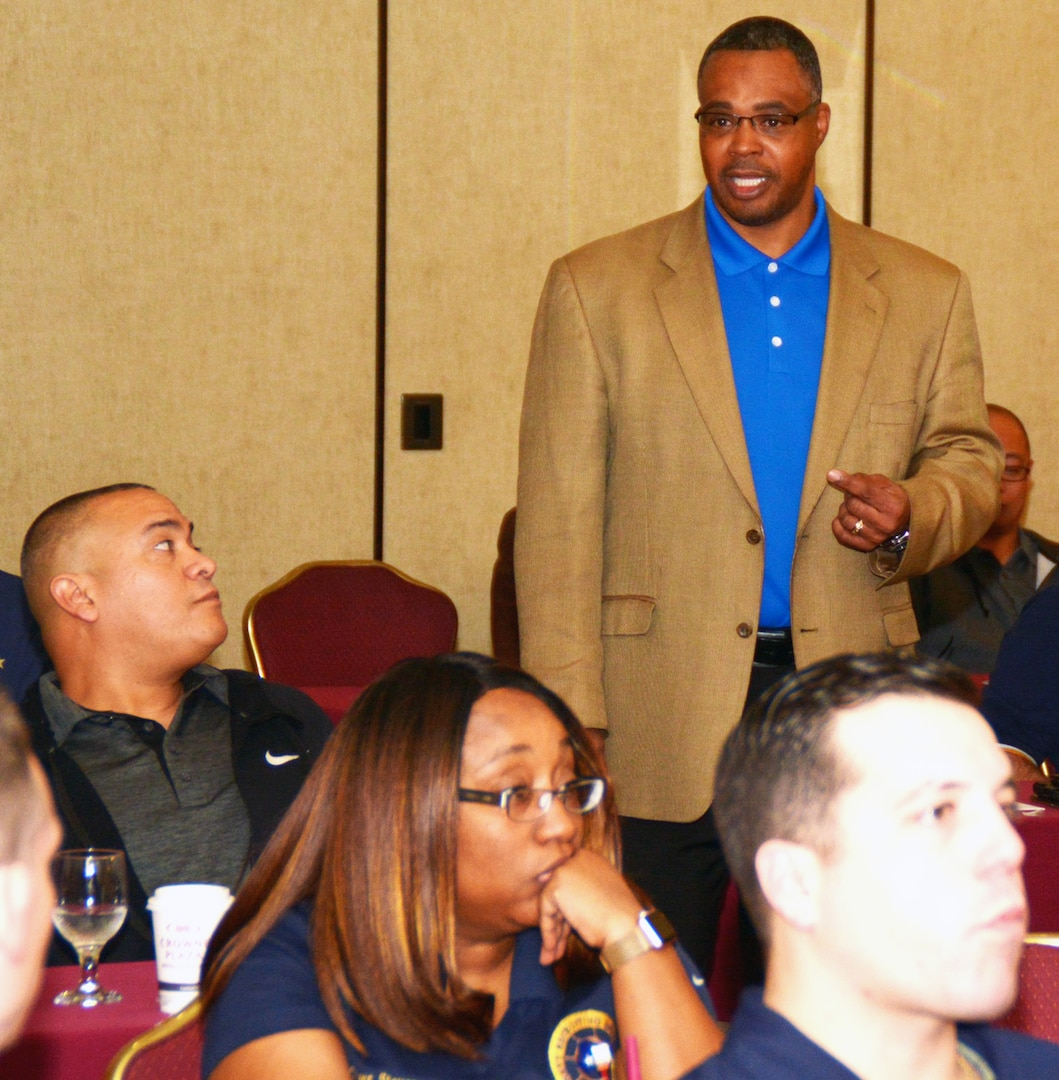 Army veteran Charles Newby, a facilitator assigned to the Navy's 21st Century Sailor office in Norfolk, Va., speaks with officers and chief petty officers of Navy Recruiting District San Antonio about Operational Stress Control during a district training meeting held at the Crowne Plaza Hotel in Austin Dec. 19. More than 250 recruiters, support personnel and their spouses attended the training where they were provided with support networks, programs, resources, training, and skills needed to overcome adversity and thrive.