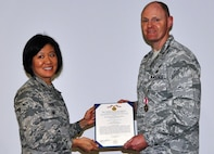 Col Janette Thode, 340th Flying Training Group commander, presents the Meritorious Service Medal to 340th FTG manpower and personnel director Lt. Col. Mark Hiatt during the December 2017 mandatory unit training assembly. (U.S. Air Force photo)