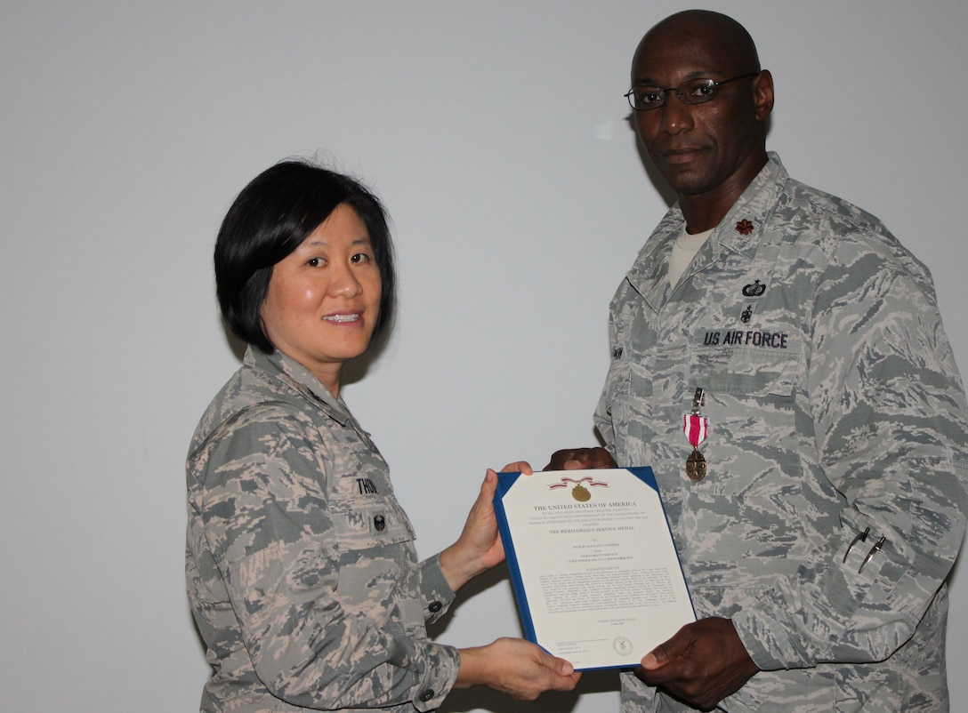Col Janette Thode, 340th Flying Training Group commander, presents the Meritorious Service Medal to 340th FTG Comptroller Maj. Thallas Lumpkin during the December 2017 mandatory unit training assembly. (U.S. Air Force photo)