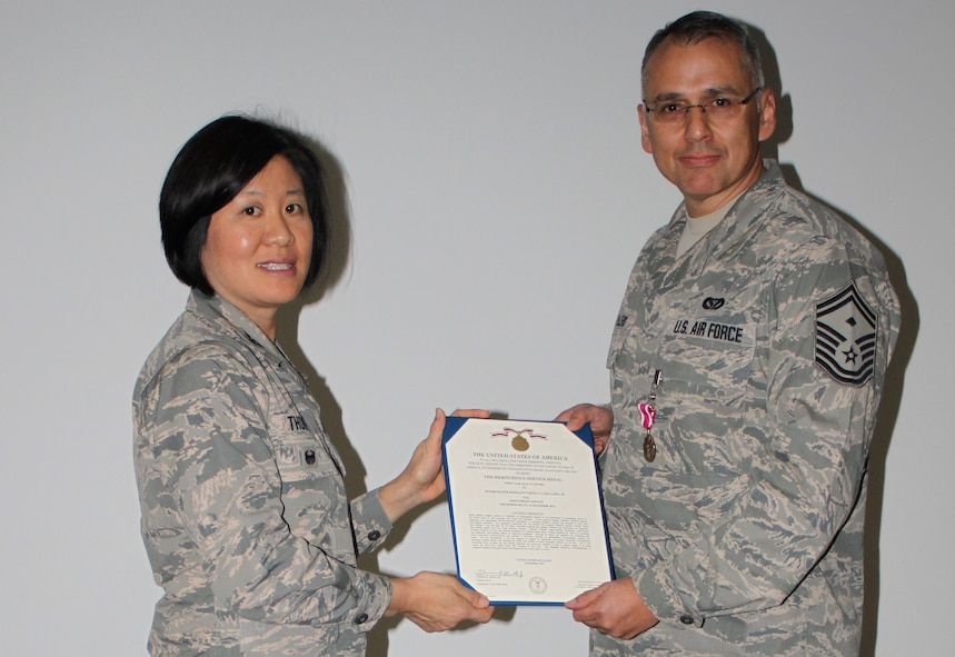 Col Janette Thode, 340th Flying Training Group commander, presents the Meritorious Service Medal to 340th FTG improvement process manager Senior Master Sgt. Samuel Caballero during the December 2017 mandatory unit training assembly. (U.S. Air Force photo)