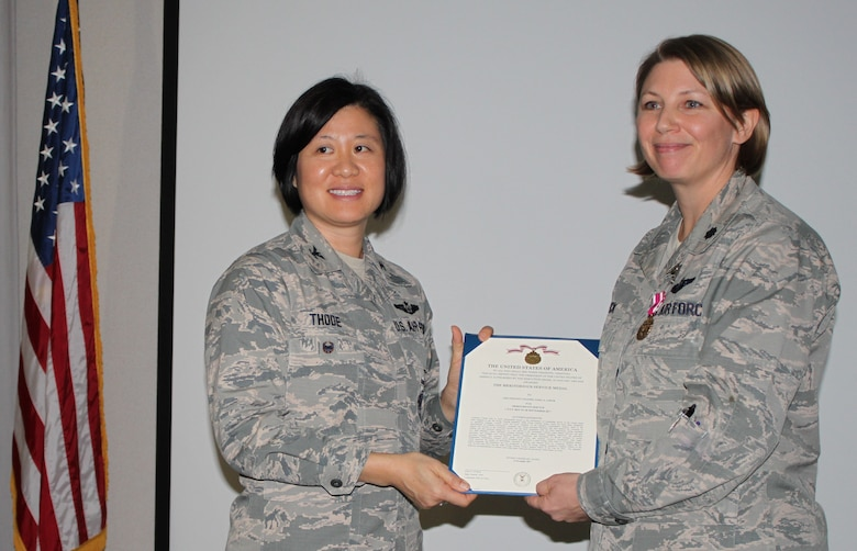 Col Janette Thode, 340th Flying Training Group commander, presents the Meritorious Service Medal to 340th FTG improvement process manager Lt. Col. Sara Linck during the December 2017 mandatory unit training assembly. (U.S. Air Force photo)