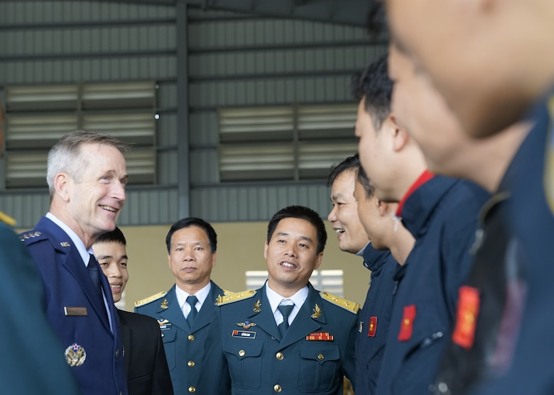 Gen. Terrence J. O'Shaughnessy, Pacific Air Forces commander, speaks with Vietnamese Air Defense-Air Force (ADAF) pilots during a base visit at Gia Lam Air Base, Vietnam, Dec. 14.