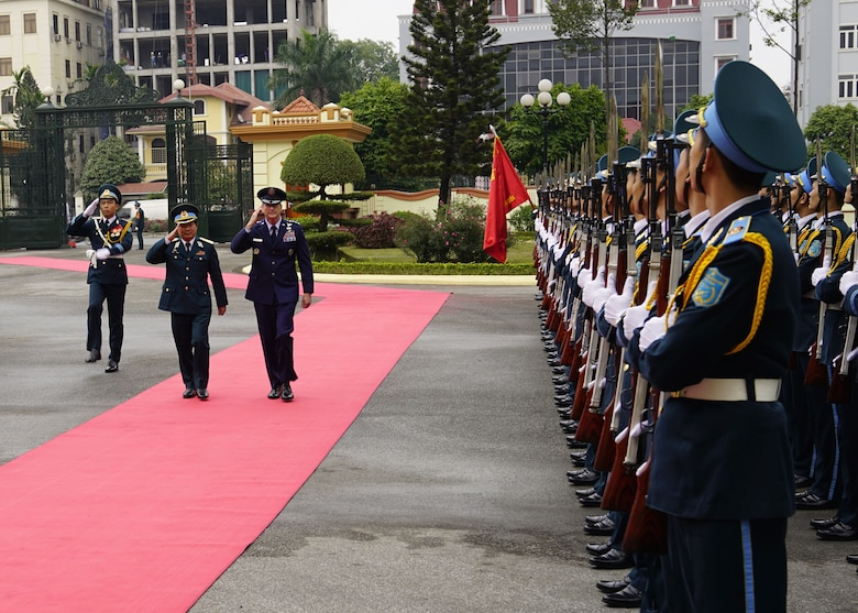 Gen. Terrence J. O'Shaughnessy, Pacific Air Forces commander and Senior Lt. Gen. Le Huy Vinh, Vietnamese Air Defense-Air Force commander, review a formation of ADAF Airmen prior to an office call at ADAF Headquarters, Hanoi, Vietnam, Dec. 14.