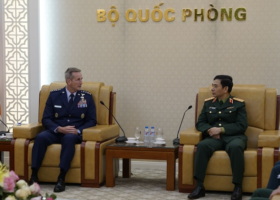 Gen. Terrence J. O'Shaughnessy, Pacific Air Forces commander, speaks with Senior Lt. Gen. Le Huy Vinh, Vietnamese Air Defense-Air Force (ADAF) commander, during an office call at ADAF Headquarters Hanoi, Vietnam, Dec. 14.