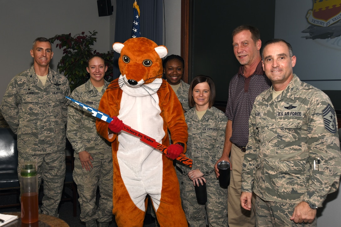 """U.S. Airmen assigned to the 20th Mission Support Group (MSG) are recognized by 20th Fighter Wing leadership and SAM Hunter, Wild Weasel mascot, as """"Shaw Weasels of the Week"""" at Shaw Air Force Base, S.C., Dec. 20, 2017."""