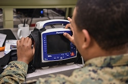 U.S. Navy Hospitalman 2nd Class Antwon Cox, 4th Medical Logistics Company, tests an electrocardiogram at Joint Base Charleston, S.C., Dec. 12, 2017.