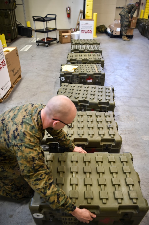 Hospitalman 2nd Class Kirby Reynolds, 4th Medical Logistics Company, packs a box with supplies at Joint Base Charleston, S.C., Dec. 18, 2017.