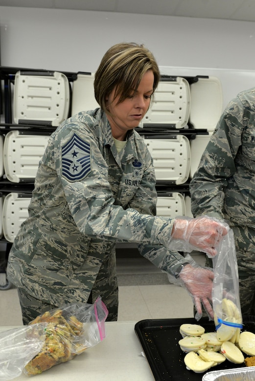 U. S. Air Force Chief Master Sgt. Bobbie Riensche, 17th Training Wing command chief, helps prepare bags of cookies at the Taylor Chapel on Goodfellow Air Force Base, Texas, for distribution to Goodfellow trainees Dec. 20, 2017. Volunteers created an assembly line of bagging and replenishing cookies in preparation for events and activities around the base over the next few days.