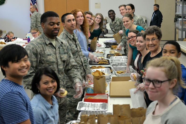 Volunteers prepare bags of cookies at the Taylor Chapel on Goodfellow Air Force Base, Texas, for distribution to Goodfellow trainees Dec. 20, 2017. The volunteers also prepared large cookie trays for various events and activities around the base for the next week.