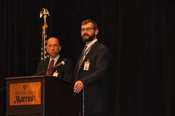 Naval Surface Warfare Center, Port Hueneme Division Chief of Contracts, Joel Walor (right), and Deputy Chief of Contracts, Nick DeSelle, provide insight regarding current and upcoming acquisition requirements, during the command's Dec. 14 Industry Day held at Ventura Beach Marriott.