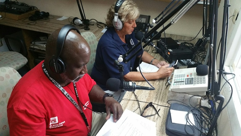 Brooks Hubbard, a Public Affairs Specialist with U.S. Army Corps of Engineers South Pacific Division provides information over radio airwaves to residents in the Houston, Texas area as part of the communications mission after Hurricane Harvey devastated the area.