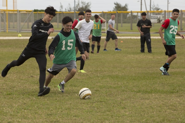 MCAS FUTENMA, OKINAWA, Japan— Two Kokusai University students compete for the ball during a soccer game Dec. 17 on Marine Corps Air Station Futenma, Okinawa, Japan.