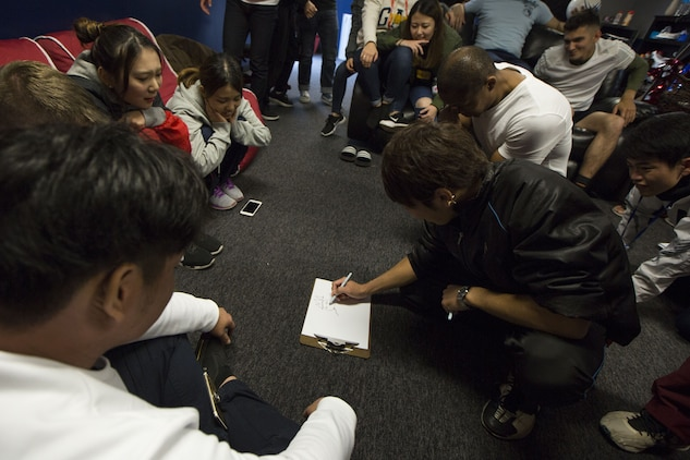 MCAS FUTENMA, OKINAWA, Japan— Nozomu Miyagi draws during a game of Pictionary Dec. 17 in the Single Marine Program building on Marine Corps Air Station Futenma, Okinawa, Japan.