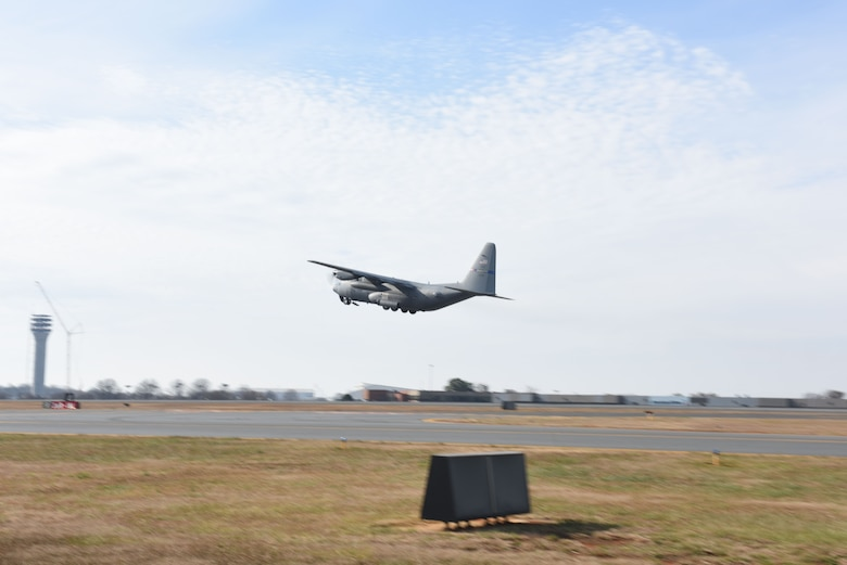 The last C-130 Hercules aircraft attached to the North Carolina Air National Guard Base, Charlotte Douglas International Airport departs for a new assignment at the 165th Airlift Wing in Savannah, Georgia, Dec. 18, 2017. The NCANG is in transition from flying the C-130 Hercules to C-17 Globemaster III aircraft. The change in mission will require not only a transition in aircraft and personnel, but an increase in structures throughout the base.