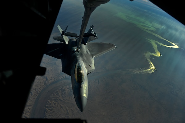 An F-22 assigned to the 380th Air Expeditionary Wing, Al Dhafra Air Base, United Arab Emirates receives fuel over Iraq [Euphrates River] from a KC-10 Extender, Nov. 29, 2017. The F-22 is a component of the Global Strike Task Force, supporting U.S. and Coalition forces working to liberate territory and people under the control of ISIS. 