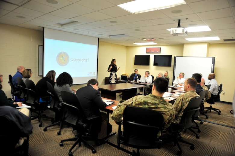 Lacey Thomasson (Standing), Silver Jackets coordinator with the U.S. Army Corps of Engineers Nashville District, briefs leadership from the Nashville District, Memphis District, Tennessee Emergency Management Agency and Tennessee National Guard during a partnering meeting at TEMA Headquarters in Nashville, Tenn., Dec. 19, 2017. (Photo by Matthew Starling)