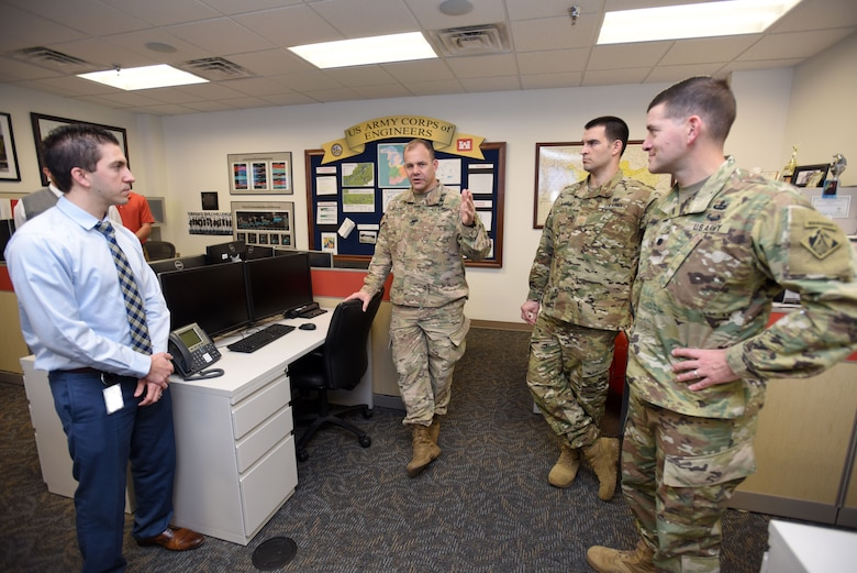 Col. Michael Ellicott Jr. (Second from Left), U.S. Army Corps of Engineers Memphis District commander and district engineer, asks questions during a tour of the Nashville District Water Management Center at the district headquarters in Nashville, Tenn., Dec. 19, 2017. Anthony Rodino, Nashville District acting chief of Hydraulics and Hydrology, briefed Ellicott and Maj. Thomas C. Darrow (Second from Right), Memphis District deputy commander; and Lt. Col. Cullen Jones, Nashville District commander; on the center's operations. (USACE photo by Lee Roberts)