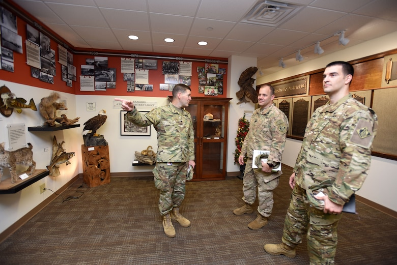 Lt. Col. Cullen Jones (Left), U.S. Army Corps of Engineers Nashville District commander; leads Col. Michael Ellicott Jr. (Middle), U.S. Army Corps of Engineers Memphis District commander and district engineer; and Maj. Thomas C. Darrow, Memphis District deputy commander; on a tour of the Nashville District Headquarters in Nashville, Tenn., Dec. 19, 2017. (USACE photo by Lee Roberts)