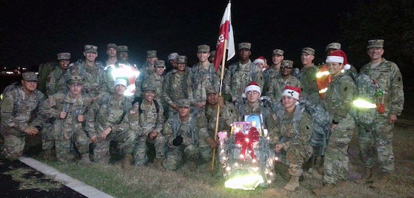 Soldiers from the U.S. Army South Headquarters Support Company gathered early Dec. 14 at the MacArthur Parade Field and stuffed lots of toys and goodies into their ruck sacks before heading off on a three-mile road march Joint Base San Antonio-Fort Sam Houston Child Development Center.