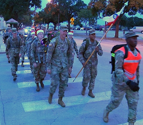 Soldiers from the U.S. Army South Headquarters Support Company head to the Joint Base San Antonio-Fort Sam Houston Child Development Center to deliver toys during their first toy ruck march Dec. 14.