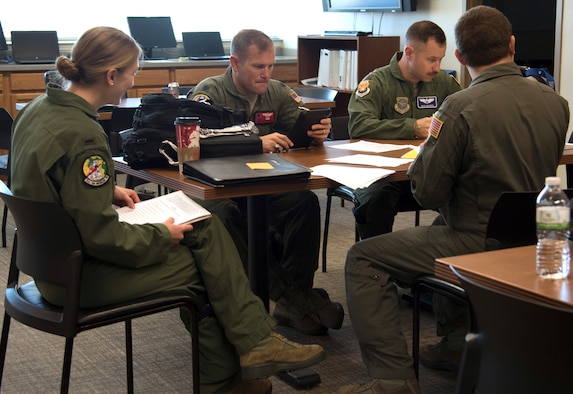 Aircrew members from the 91st and 50th Air Refueling Squadrons meet for a pre-flight mission brief at MacDill Air Force Base, Fla., Dec. 19, 2017. While the 50th continues to settle into their new home, both squadrons have been working as one to ensure their missions are achieved. (U.S. Air Force photo by Airman 1st Class Ashley Perdue)