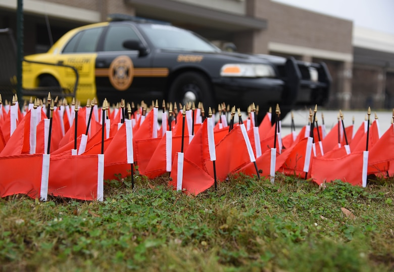 More than 200 red flags, representing the number of DUI fatalities in Mississippi for 2016, are on display in front of the Commissary Dec. 19, 2019, on Keesler Air Force Base, Mississippi. The flags were placed by the Alcohol Drug Abuse Prevention and treatment center. December is Impaired Driving Awareness Month. (U.S. Air Force photo by Kemberly Groue)
