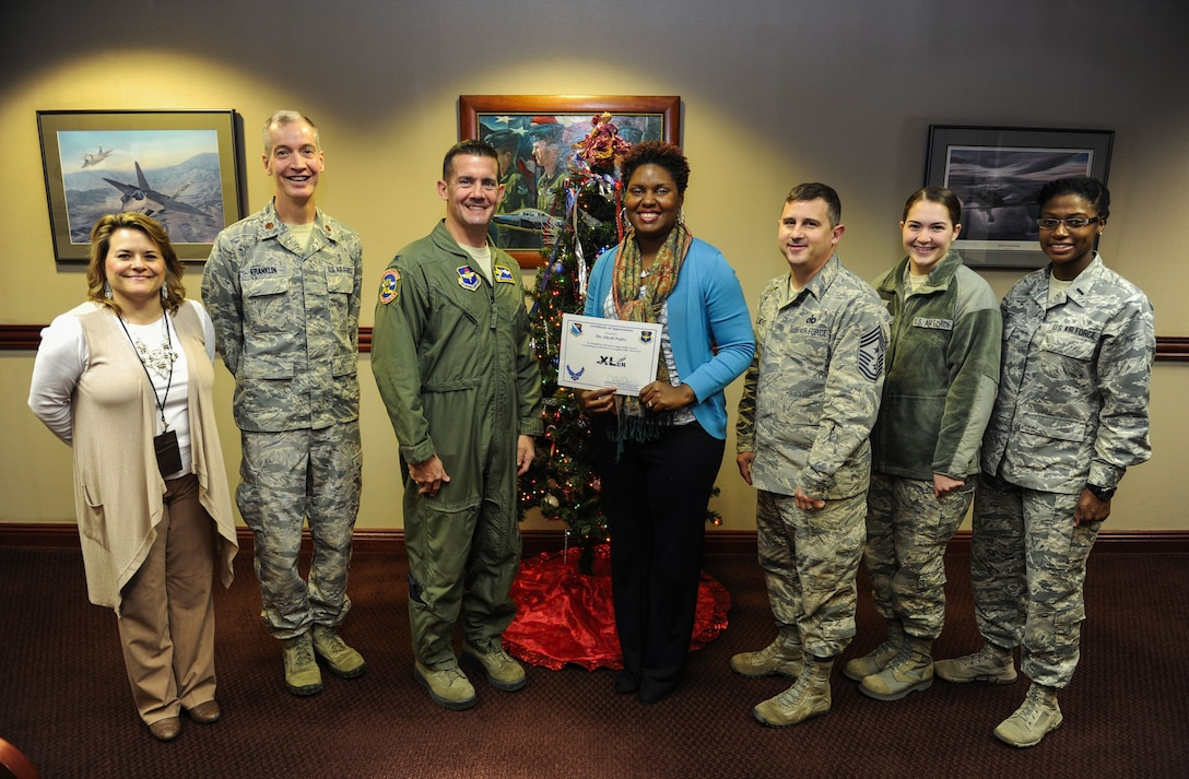 "Aliyah Negley, 47th Flying Training Wing community support coordinator, was chosen by wing leadership to be ""XLer of the week"", for the week of Dec. 13, 2017. The ""XLer"" award, presented by Col. Charlie Velino, 47th Flying Training Wing wing commander, is given to those who consistently make outstanding contributions to their unit and the Laughlin mission."