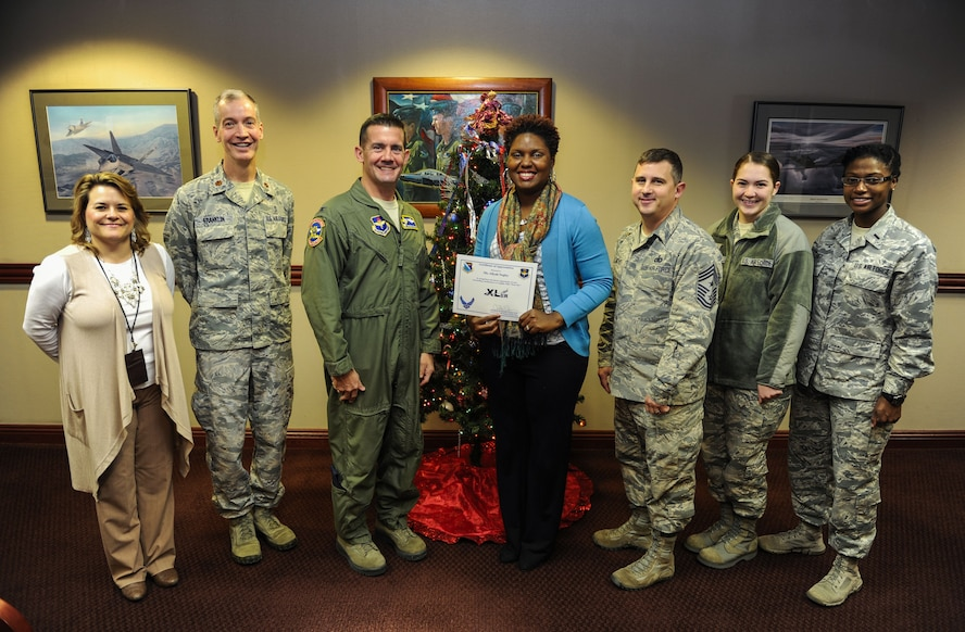 """Aliyah Negley, 47th Flying Training Wing community support coordinator, was chosen by wing leadership to be """"XLer of the week"""", for the week of Dec. 13, 2017. The """"XLer"""" award, presented by Col. Charlie Velino, 47th Flying Training Wing wing commander, is given to those who consistently make outstanding contributions to their unit and the Laughlin mission."""