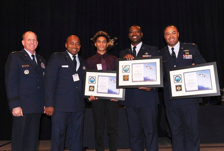 "Moody Airmen accept the Distinguished Volunteer award during the 2017 National Public Benefit Flying Awards, Nov. 29, in Arlington, Va. Awarded for the success of hosting a youth aviation event in honor of the Tuskegee Airmen, they coordinated the largest Legacy Flight Academy's ""Eyes Above the Horizon"" diversity outreach event. This past summer, they gave approximately 100 South Georgian youth a chance to fly and explore aviation and Science, Technology, Engineering, and Mathematics career opportunities. (Courtesy photo)"