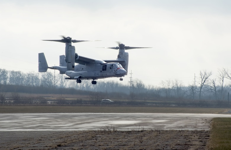 An U.S. Marine Corps MV-22 Osprey belonging to Air Test and Evaluation Squadron 21 (HX-21) makes its approach to a runway on Wright-Patterson Air Force Base, Ohio, Area B, near the National Museum of the Air Force Dec. 19, 2017. The aircraft was signed over to Naval Medical Research Unit-Dayton to be used in research to minimize injuries to aircrew members. (U.S. Air Force photo by R.J. Oriez)