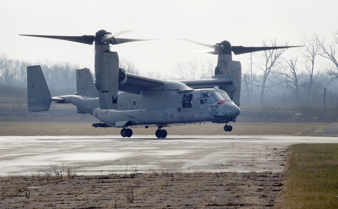 An U.S. Marine Corps MV-22 Osprey belonging to Air Test and Evaluation Squadron 21 (HX-21) lands at Wright-Patterson Air Force Base, Ohio, Area B, near the National Museum of the Air Force Dec. 19, 2017. The aircraft was signed over to Naval Medical Research Unit-Dayton to be used in research to minimize injuries to aircrew members. (U.S. Air Force photo by R.J. Oriez)