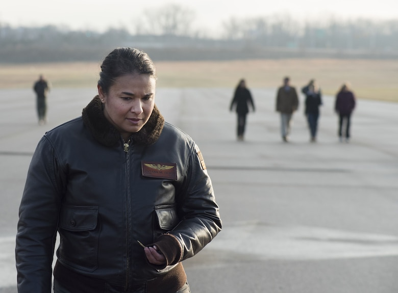 Navy Cmdr. Tatana Olson, Naval Aerospace Medical Research Laboratory deputy director, joins her Naval Medical Research Unit-Dayton shipmates in a foreign-object-damage walk-down Dec. 19, 2017, on the Wright-Patterson Air Force Base, Ohio, Area B flight line in preparation for the arrival of a Marine Corps MV-22 Osprey aircraft. The aircraft was acquired by NAMRU-D to be used in research to minimize injuries to aircrew members. (U.S. Air Force photo by R.J. Oriez)