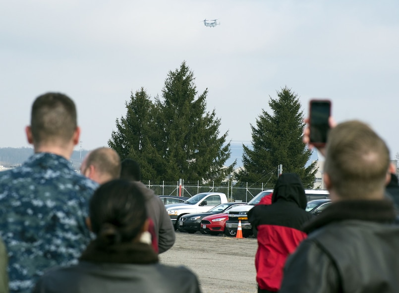 Members of Naval Medical Research Unit-Dayton watch a Marine Corps MV-22 Osprey approach over Wright-Patterson Air Force Base, Ohio, Dec. 19, 2017. NAMRU-D was acquiring the aircraft for use in medical research with the goal of minimizing injuries to aircrew members and maintenance workers. (U.S. Air Force photo by R.J. Oriez)