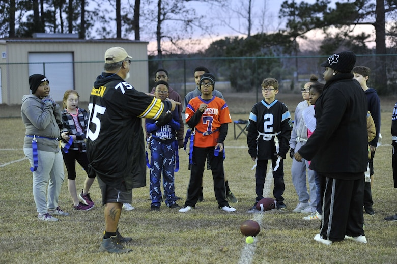 Children with the Weapons Station youth center receive a final pep talk before beginning a flag football game Dec. 14, 2017, at Joint Base Charleston – Weapons Station, S.C.