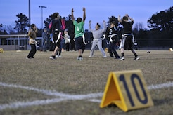 Children with the Weapons Station youth center warm-up for a flag football game Dec. 14, 2017, at Joint Base Charleston – Weapons Station, S.C.