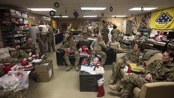 Members of the 455th Expeditionary Aeromedical Evacuation Squadron participate in a white elephant gift exchange Dec. 25, 2016 at Bagram Airfield, Afghanistan. The mission continued over the holiday, but service members took time to celebrate the holiday by talking with their families and spending time with their units.