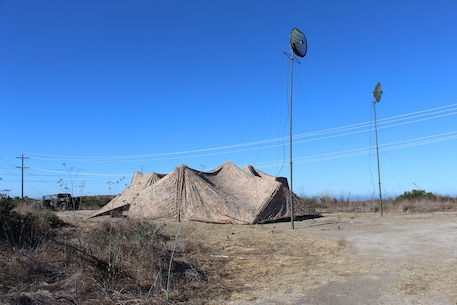 A small detachment from 9th Communication Battalion establishes a full service communications node during Battalion Field Training Exercise 1-17. The Battalion uses camouflage netting to conceal the assets at the site.