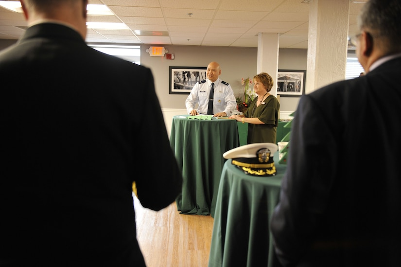 U.S. Air Force Col. Jimmy Canlas, 437th Airlift Wing commander, expresses his appreciation to attendees through a speech Dec. 15, 2017, at Coast Guard Sector Charleston's Brass Buckle conference room.
