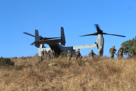 A detachment from 9th Communication Battalion offloads from a MV-22 while conducting a refueling mission as part of the Battalion Field Exercise 1-18.   Beyond communications, Marines trained on land navigation, security, and flight operations during the exercise.