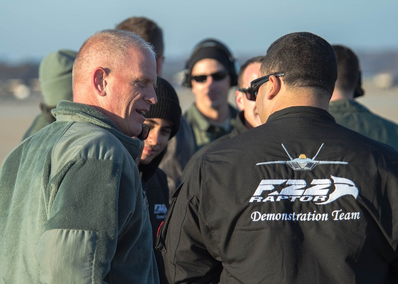 U.S. Air Force Chief Master Sgt. Frank Batten, command chief of Air Combat Command, speaks with the F-22 Raptor Demonstration Team during a performance at Joint Base Langley-Eustis, Va., Dec. 18, 2017.