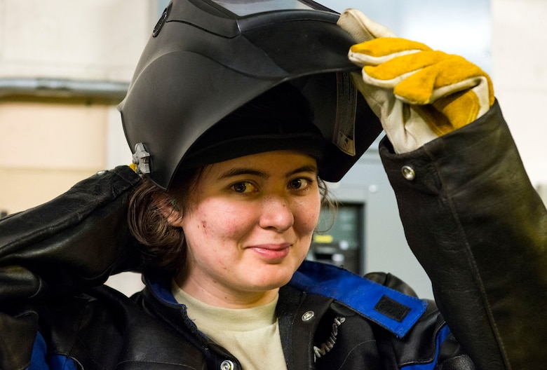Airman 1st Class Heather Chambers, 23d Maintenance Squadron aircraft metals technology journeyman, poses for a photo, Dec. 19, 2017, at Moody Air Force Base, Ga. Metals technology technicians strive for perfection when fabricating and repairing Team Moody's aircraft and equipment to ensure they maintain their continual high ops tempo. (U.S. Air Force photo by Airman 1st Class Erick Requadt)
