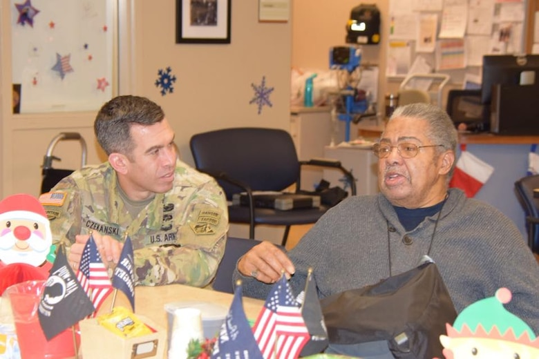 Local service members from the U.S. Army Corps of Engineers, Buffalo District, U.S. Coast Guard Sector Buffalo, Niagara Falls Air Reserves Station and the Buffalo Military Entrance Processing Station delivered holiday cards and visited with veterans of the Veterans Affairs Adult Day Health Care center, Dec. 20, 2017.