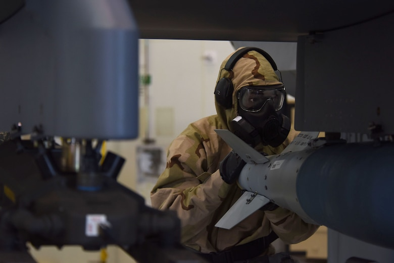 An Airman assigned to the 432nd Aircraft Maintenance Squadron Reaper Aircraft Maintenance Unit loads a GBU-38 Joint Direct Attack Munition during a weapons load competition Dec. 8, 2017, at Creech Air Force Base, Nev. Weapons load competitions are composed of a written test, tool kit evaluation, and a weapons load where safety procedures and time are closely monitored. (U.S. Air Force photo by Airman 1st Class Haley Stevens)