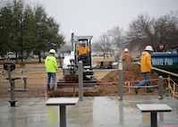 Contractors from J.A. Dawson & Co. prepare to install an awning over a new fitness station on the Fit Trail Dec. 19, 2017, on Columbus Air Force Base, Mississippi. The 14th Force Support Squadron, 14th Civil Engineer Squadron and the 14th Contracting Squadron work hand in hand to provide Columbus AFB service members and families with equipment and opportunities they can use to enhance their quality of life. (U.S. Air Force photo by Airman 1st Class Keith Holcomb)
