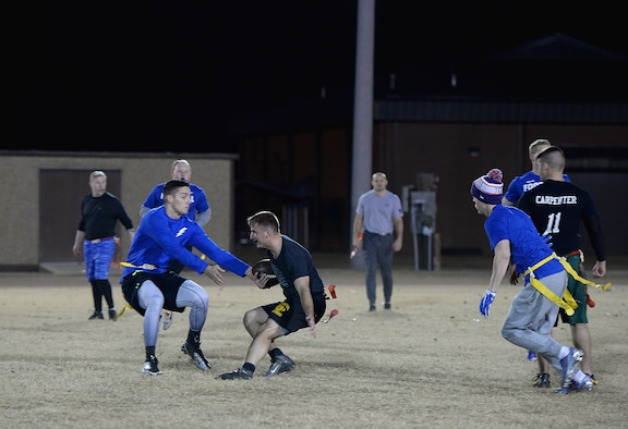 Staff Sgt. Nicholas Bahr, 14th Operations Support Squadron, makes his way through defenders on his way to the end zone Dec. 14, 2017, on Columbus Air Force Base, Mississippi, during the Columbus AFB intramural flag football championship. The final game was a back-and-forth between the two top squadrons on base, the 14th OSS and the 14th Student Squadron. The OSS won by a score of 20-7.  (U.S. Air Force photo by Airman 1st Class Keith Holcomb)
