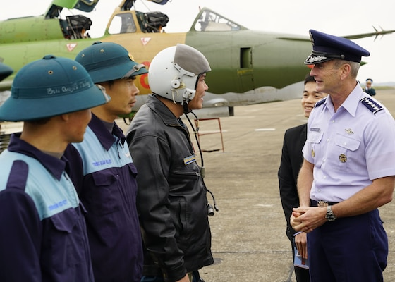 HO CHI MIN CITY, Vietnam -  Gen. Terrence J. O'Shaughnessy, Pacific Air Forces commander, talks with a Vietnamese Air Defense-Air Force (ADAF) pilot, Noi Bai Air Base, Vietnam, Dec. 15. O'Shaughnessy and Chief Master Sgt. Anthony Johnson, PACAF command chief, visited the country to affirm the United States' shared commitment to peace and prosperity in the Indo-Pacific region, as well as to seek opportunities for advancing partnership and cooperation with the ADAF.